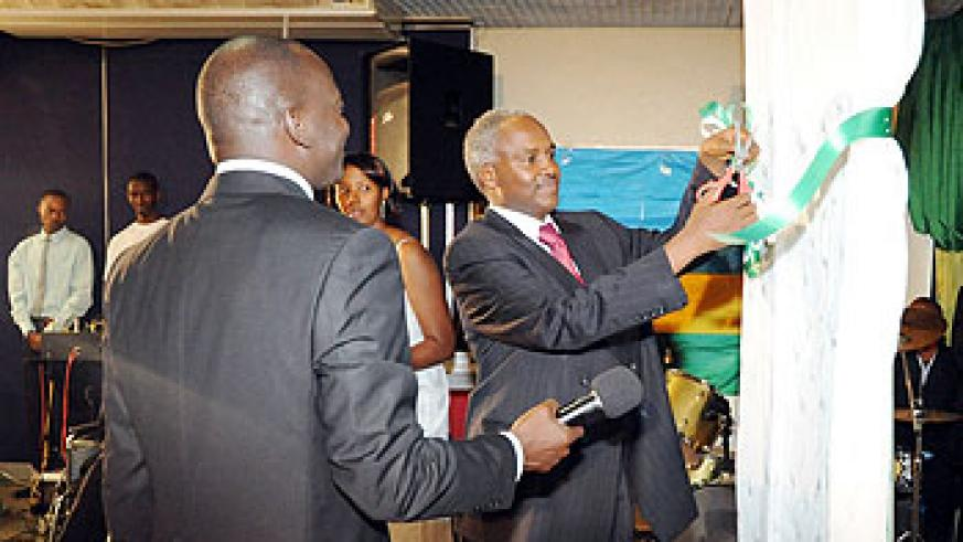 Dr. Charles Muligande cutting the ribbon to launch the campaign (Photo;J. Mbanda)