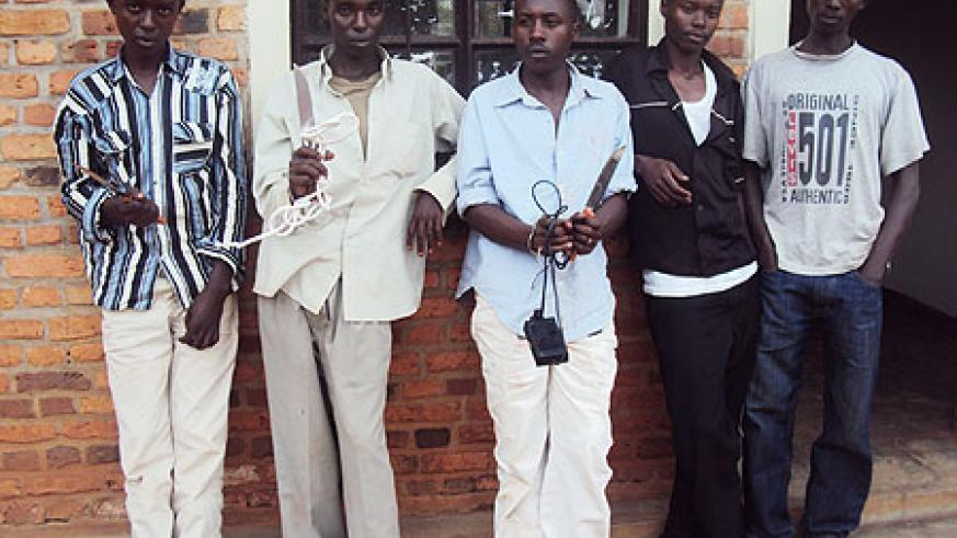 The suspects being paraded at Rwamagana Police Station with some of their weapons (Photo; S. Rwembeho)