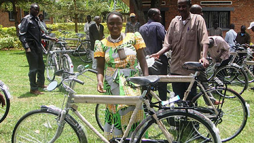 Bernadette Namakura one of the mediators admires her bicycle (Photo; S. Rwembeho)