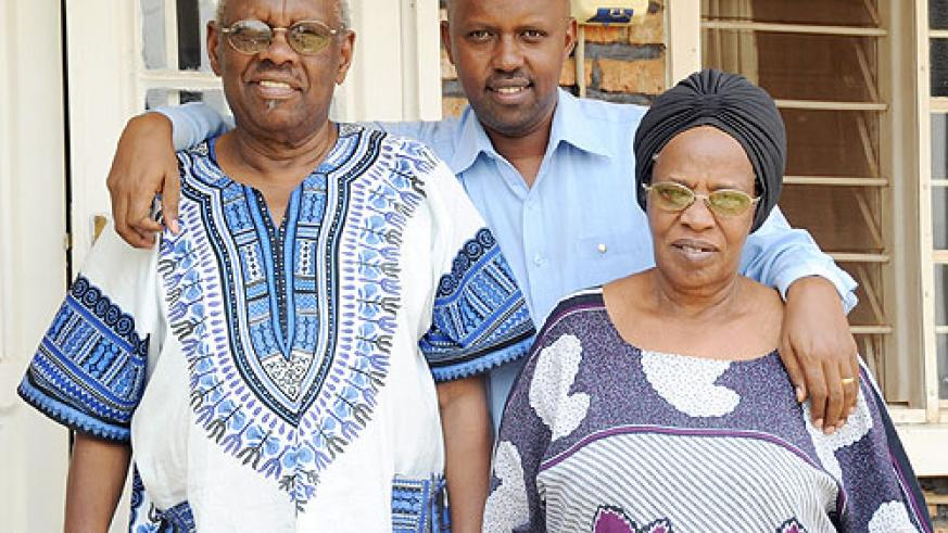Mzee zirimwabagabo (L) with their last born Nils (C) and Mukaferesi at their home in Kabeza. (Photo by Timothy .K.)