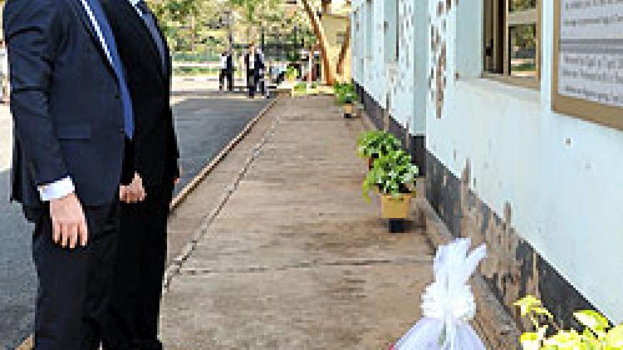 L-R; Charles Michel and Andris Piebalgs honouring the fallen Belgian  soldiers at Camp Kigali yesterday (Photo T. Kisambira)