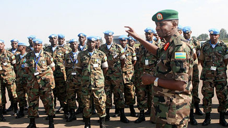 Lt. Gen. Caesar Kayizari addressing the returning soldiers yesterday at Kigali International Airport (Courtesy photo)