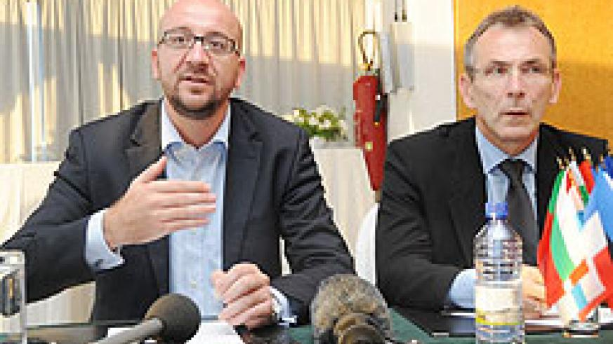 Charles Michel and Andris Piebalgs, the EU commissioner of Development at a press conference (Photo; T. Kisambira)