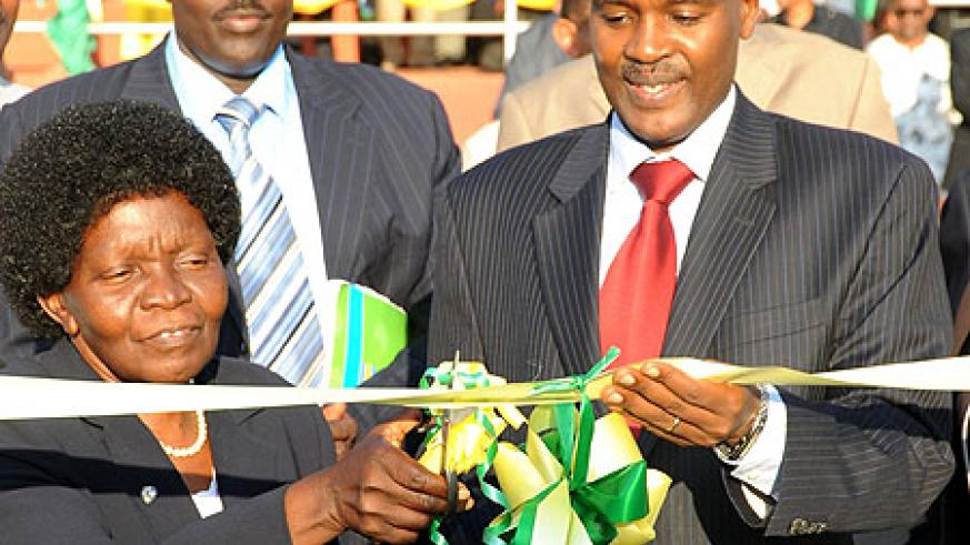 Uganda's Minster of Education, Namirembe Bitamazire (L) with Dr. Charles Murigande openning the Expo yesterday. (Photo; T. Kisambira)