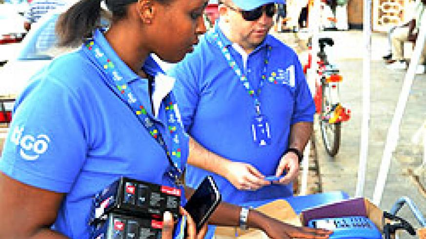 Tigo's Marketing Manager Ndabaneze and CEO Marcelo Aleman selling products to revellers recently (File Photo)