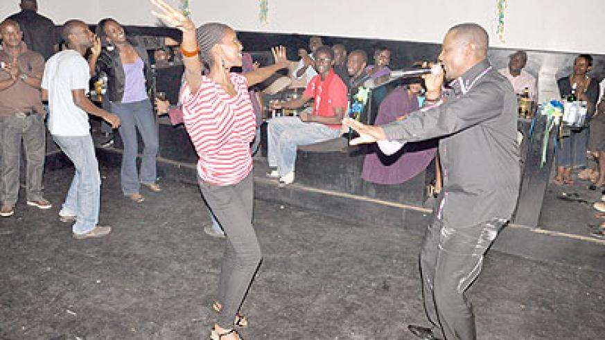 Massamba joined on stage by one of his fans.