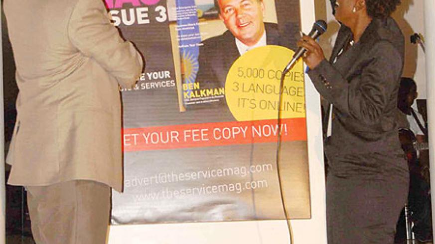 (L-R) The CEO of RDB, John Gara and Sandra Idossou unveil the third issue of the ServiceMag. (All photos by Malik Shaffy)