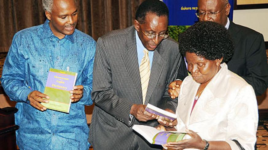 (L-R) Dr. Charles Murigande, Prof. Geoffrey Rugege and Uganda's Minister of Education, Geraldine Bitamazire during the launch of the dictionary (Photo; T. Kisambira)