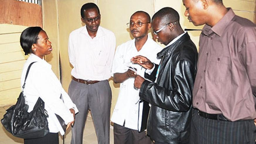 Minister of trade, Monique Nsanzabaganwa touring the closed millers yesterday (Photo; T. Kisambira)