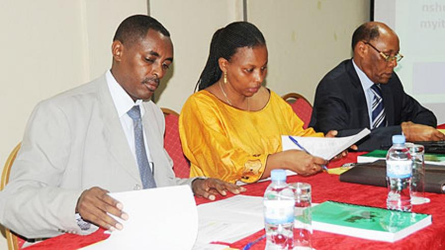 The Executive Secretary of CNLG, Jean de Dieu Mucyo (L) and other officials during the meeting (Photo; T. Kisambira)