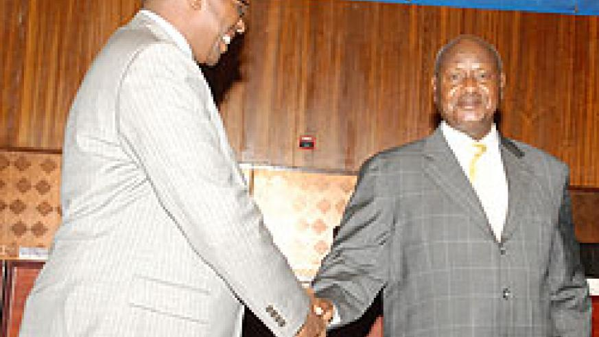 The Minister of Local Government, James Musoni (L) with President Yoweri Museveni at the conference (Photo; E. Kabeera)