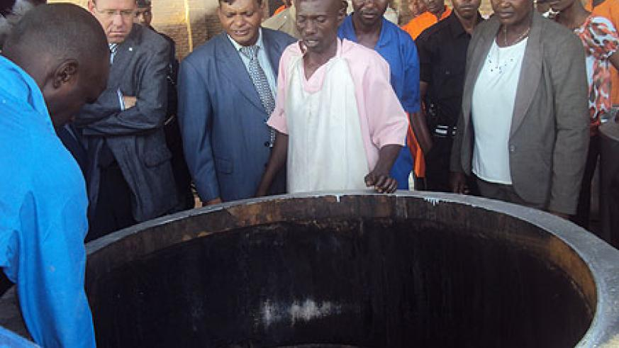 Mary Gahonzire (extreme left) and other officials inspecting biogas cooking facility at Nsinda prison (File photo)
