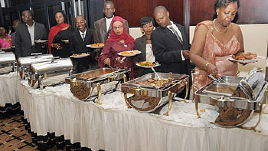 Dinner time. Guests service themselves at the celebrations.Uganda's Isaiah