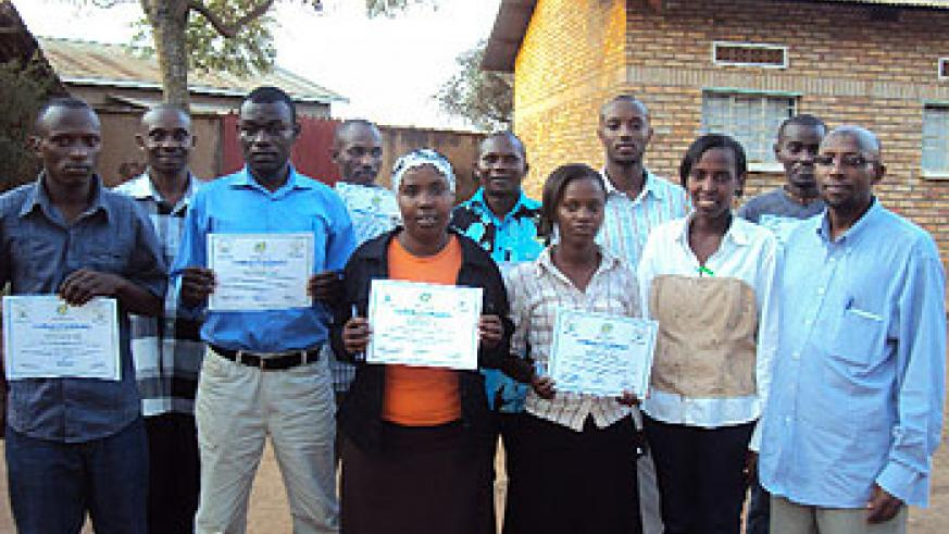 Mugina sector local leaders pose with RISD staff after receiving certificates of participation (Photo; D.Sabiiti)
