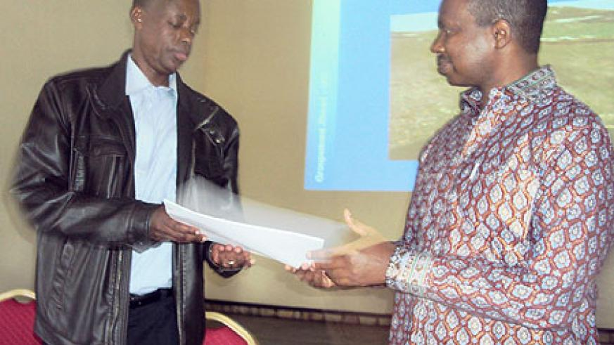 Minister Karega hands over symbolic documents to Gen Kabarebe, the new Rubavu guardian (Photo / R.Mugabe)