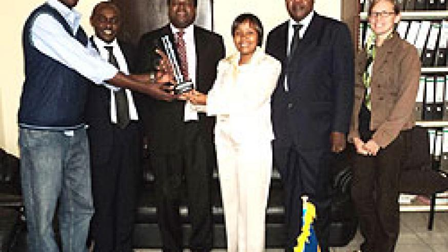 KIST rector and the staff posing for a photo with the prize (Photo F Ndoli)