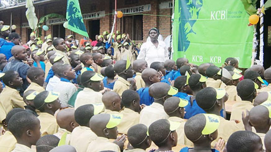 KCB lent support to  over 700 pupils of Mubona Primary School as part of its social responsibility programmes. (Photo: B. Mukombozi)