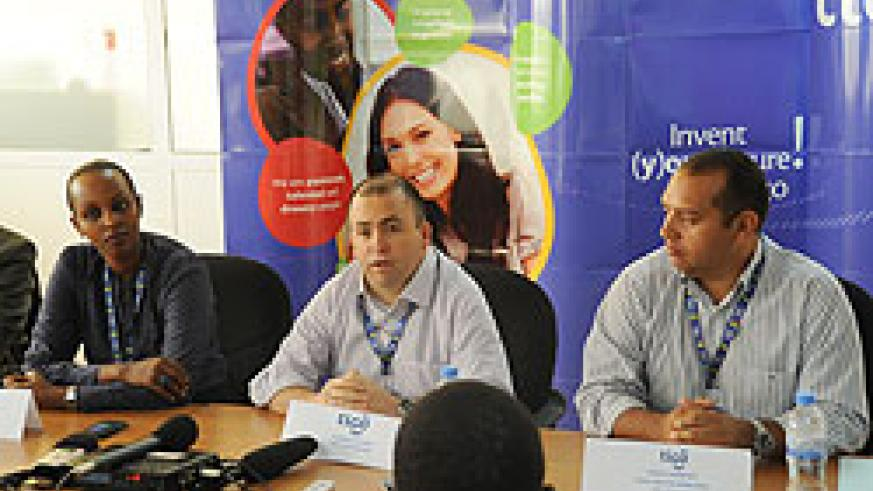 Tigo CEO Marcelo Aleman (middle) addresses journalist during the launch of the 'Ba Free' promotion recently (File Photo)