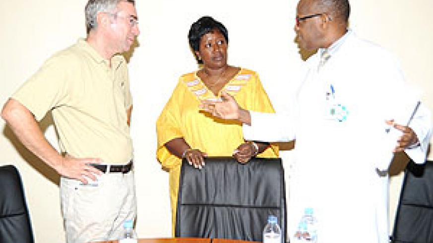 L-R; Dr. Thierry Sluysmans, Dr. Agnes Binagwaho and Dr. Emille Rwamasirabo in a discussion after the press conference (Photo; J. Mbanda)