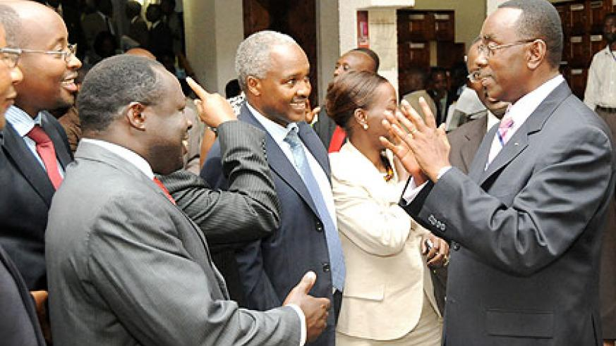 Prime Minister Bernard Makuza (R) sharing a light moment with Ministers of the Cabinet after presenting the government's 7-year programme to both chambers of Parliament yesterday. (Photo T.Kisambira)