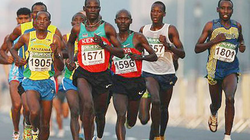 Disi (extreme right) hobbled out of the race after just 10km. Kenya's John Kelai led from the front as he won the marathon.