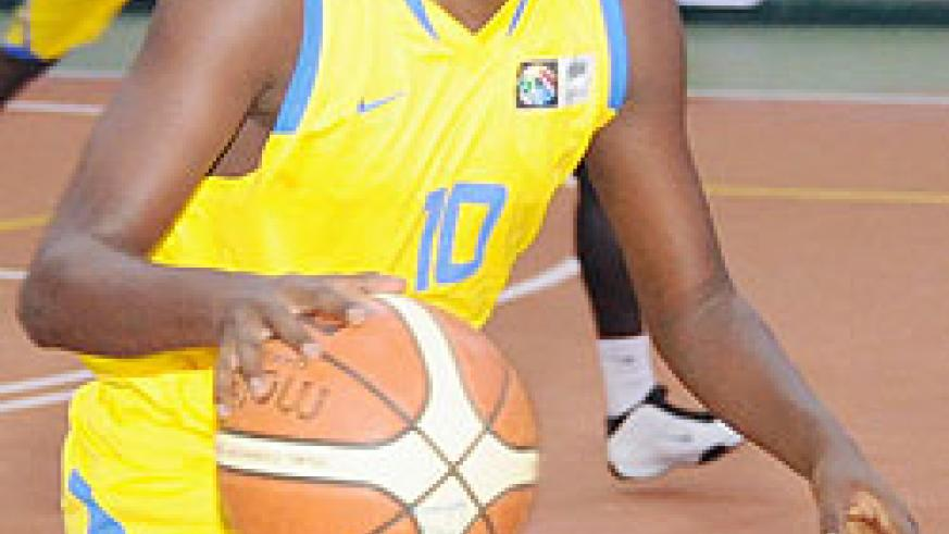 Rwanda's Igor Mugisha drives in for a lay-up during the Congo-Brazzaville game. Rwanda face Tunisia in one of four quarter-final matches this afternoon. (Photo: T. Kisambira)