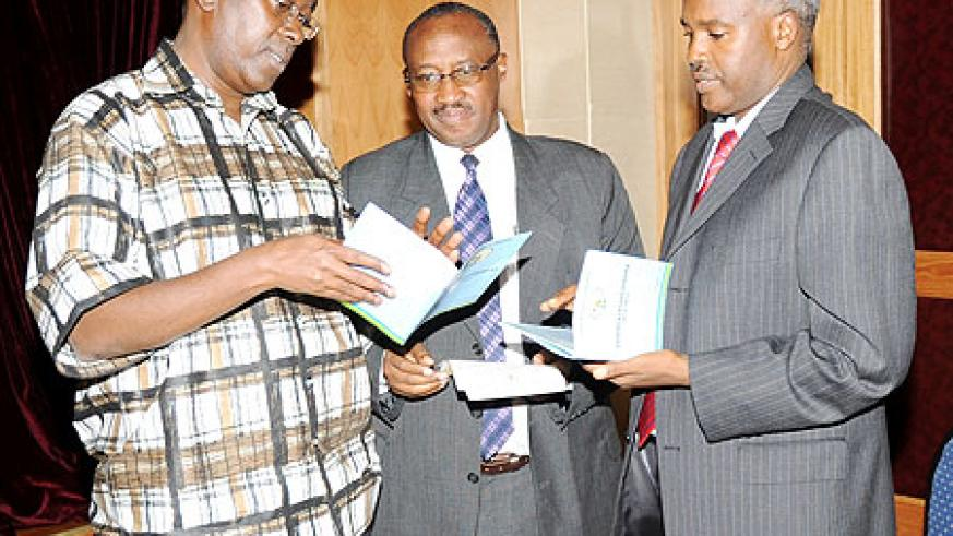 Prime Minister Bernard Makuza (L) with Ministers Protais Musoni (C) and Charles Murigande read through the 2010-2017 Government roadmap paper yesterday. (Photo J Mbanda)