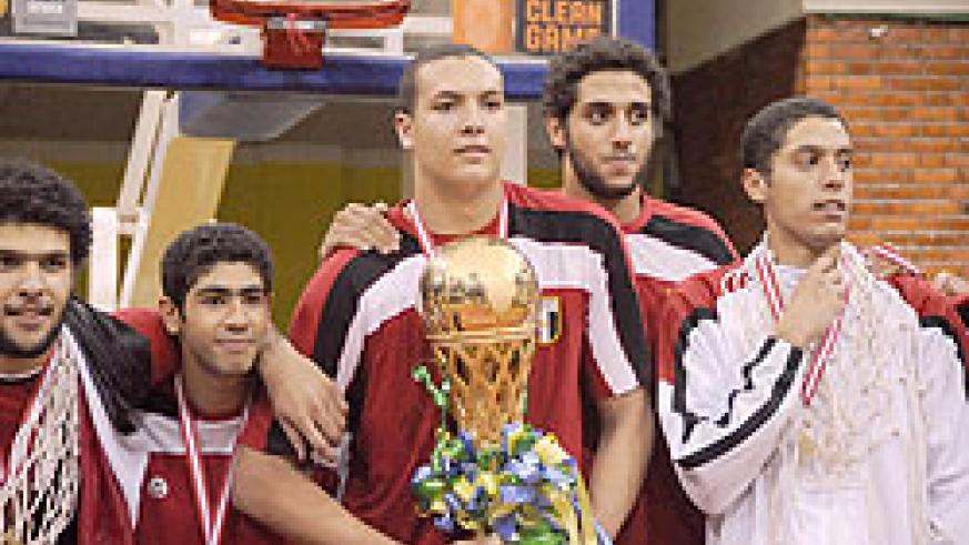 Egypt's Aly Mohammad showing off the winners' trophy yesterday at Amahoro Indoor Stadium. (Photo T. Kisambira)