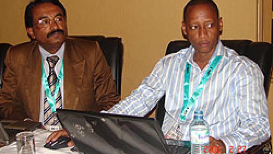 Prof. Jose Mathai (L) flanked by Pierre Clever Rutayisire of NUR during the conference in Kampala last week (Photo; E. Kabeera)