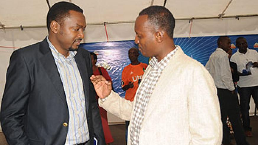 The CEO Ferwafa, Jules Kalisa chats with his colleague, the Vice President of Ferwafa, Raoul Gisanura.