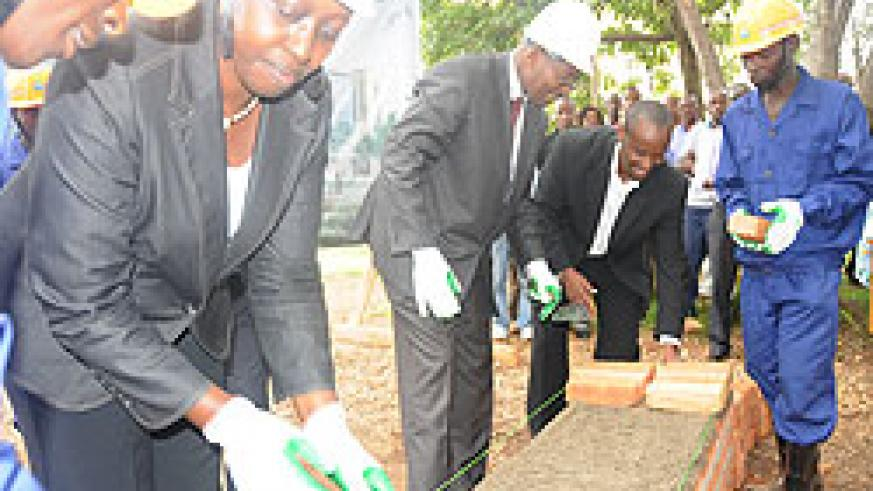 The Minister of Local Government, James Musoni (R) and Dr Aisa Kirabo during the laying of the foundation (Photo; S. Mugisha)