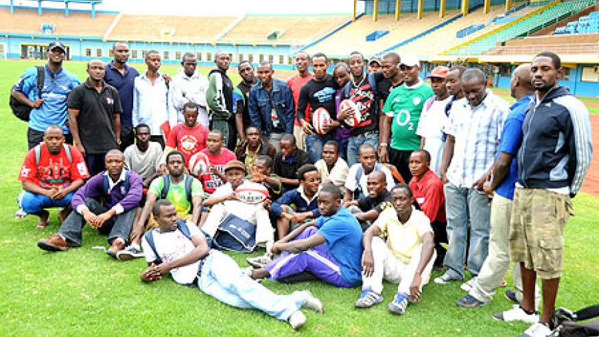 The participants pose for a photo with trainers, John Bosco Muamba (Standing 2nd Left) and Erick Situma (extreme right). (Photo T.Kisambira)