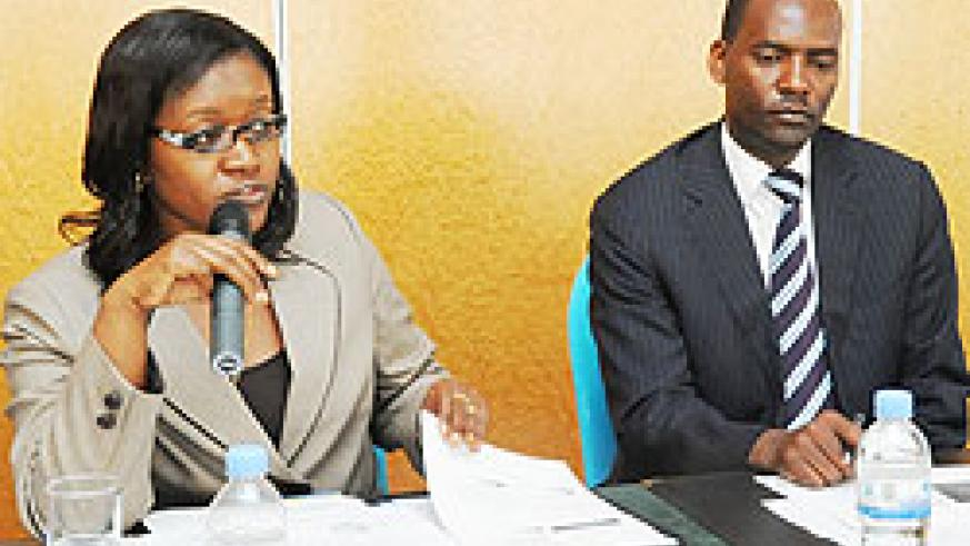 Minister Monique Mukaruliza and Robert Ssali during the workshop yesterday (Photo T. Kisambira)