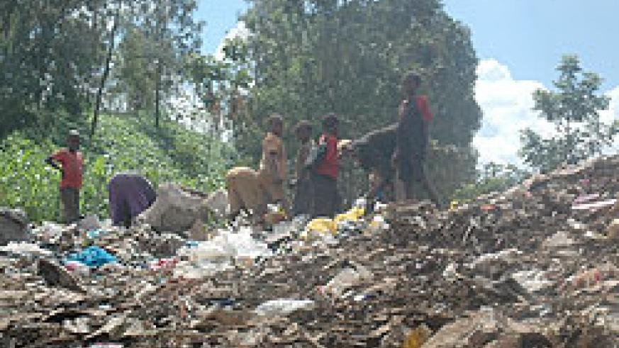 TO BE PHASED OUT; Children going through the garbage heap at Nyanza Landfill (File photo)
