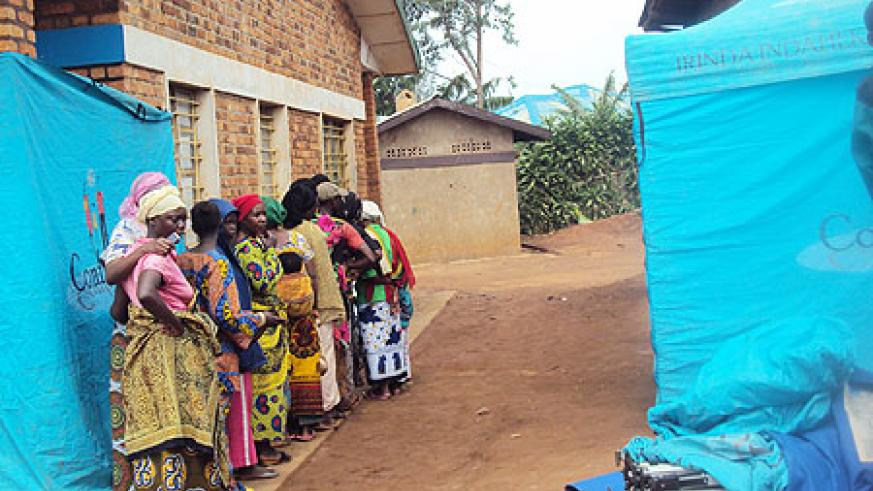 Rural residents lining up  for the new testing  and counseling services. Photo by S. Rwembeho.