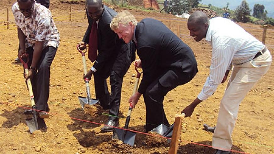 Bay View Group president Dr Roderick Marshal and KHI's Eugene Seminega (L) join local leaders in the ground-breaking ceremony of the construction of the new facility. Photo S Nkurunziza