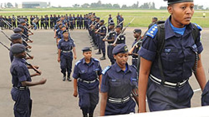 Policewomen boarding a Rwandair flight to Darfur yesterday at Kigali International Airport (Photo; T. Kisambira)