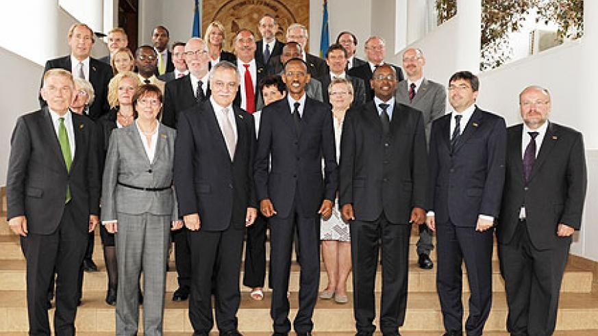 President Kagame in a group photo with the visiting German delegation, yesterday (Photo; Urugwiro Village)