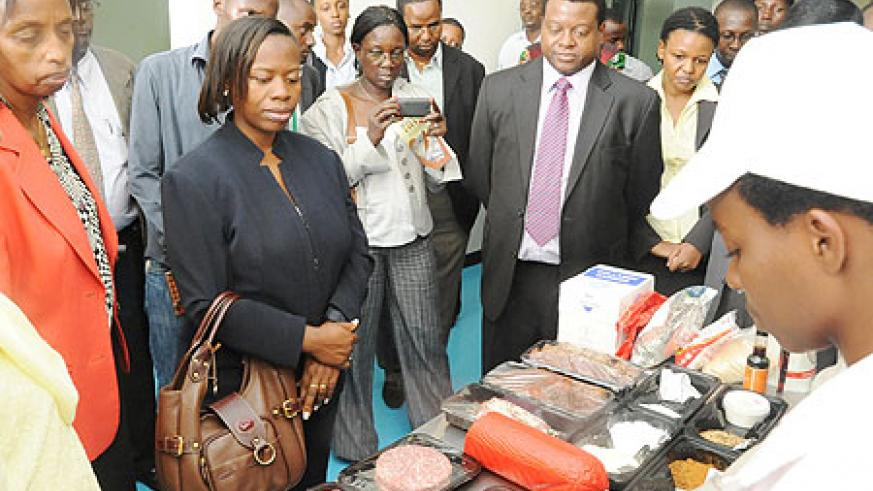 The Minister of Trade, Monique Nsazabaganwa, being shown around the facility (Photo; T. Kisambira)