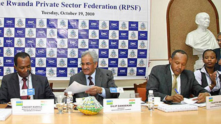 (L-R)Minister Karega, Dandekar of the Indian Merchants Chamber of Commerce, Faustin Mbundu of PSF and Claire Akamanyi of RDB at the MOU signing ceremony (courtesy photo)