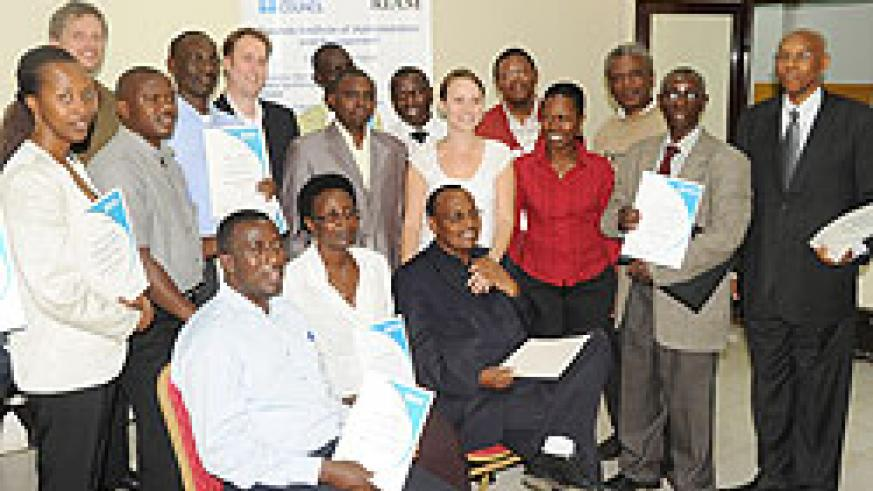 Some of the civil servants who participated in the English training with their certificates (Photo; T. Kisambira)