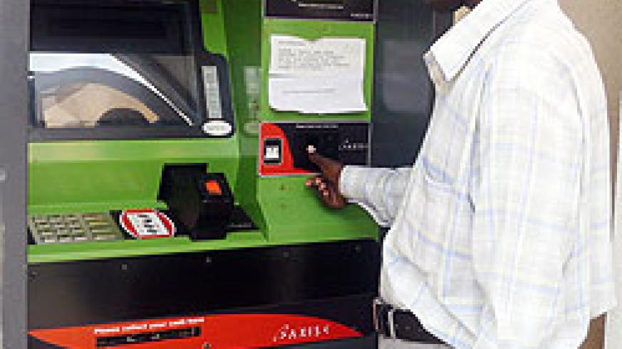 A customer using an ATM, Central Bank needs increased ATM transaction to keep liquidity in the banking system and cut banking costs (File photo)
