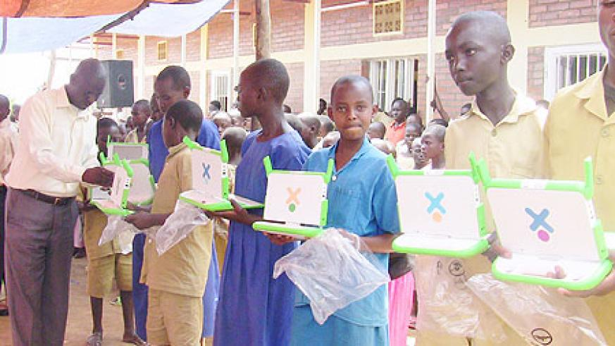 Mayange Primary School pupils receiving the laptops. (Photo: S. Rwembeho)