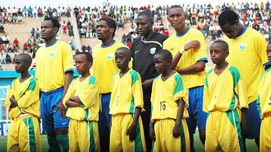 Amavubi players line up during one of Rwanda's 2010 CAN qualifiers last year. (File Photo)