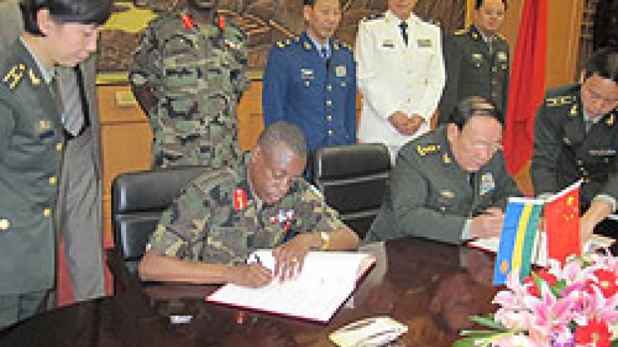 The Minister Oof Defence, Gen. James Kabarebe and his Chinese counterpart,Gen Liang Guanglie, signing the cooperation agreement yesterday.