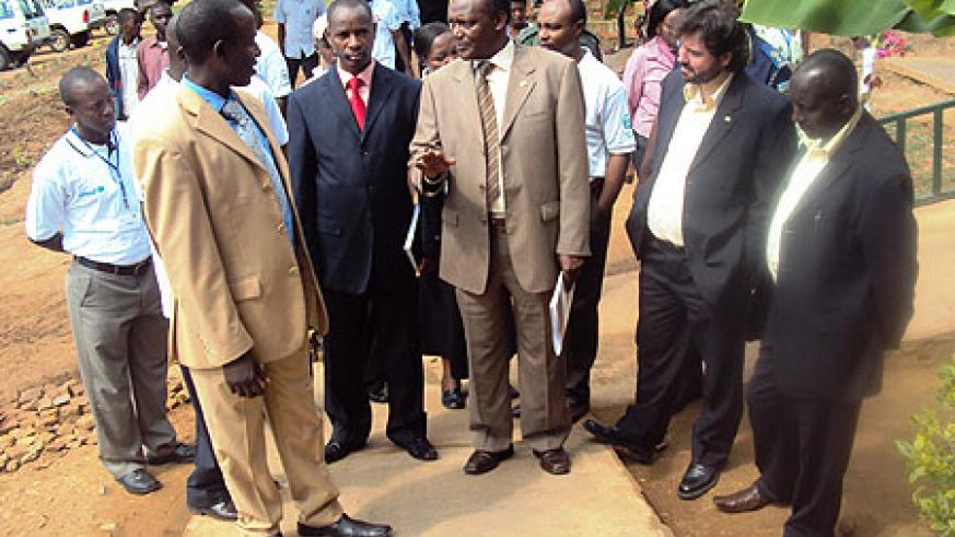 Dr. Charles Nkuranga (C), local leaders and ADRA officials touring the project (Photo; S. Rwembeho)