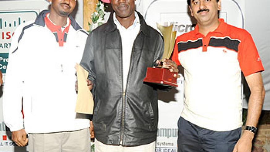 Winner's smile: Joseph Semwaya (C) gets his prize after winning the Presidents Cup on Sunday. On the left is former Kigali Golf Club president Marcel Byusa and tournament sponsor, Bin Thomas. (Photo: J. Mbanda)