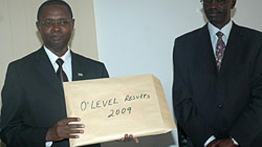The State Minister for Primary and Secondary Education,Dr. Mathias Harebamungu (L) displays 2009 O'Level results as RNEC's John Rutayisire looks on (File photo)