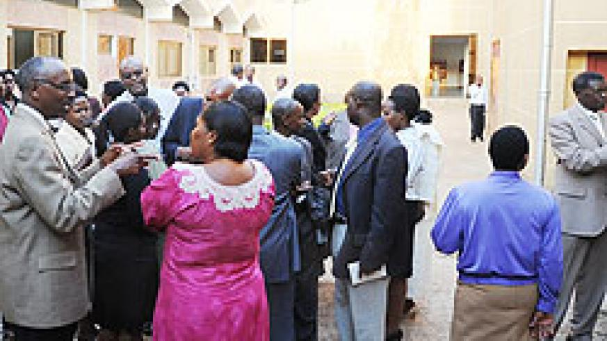 Members of Parliament during consultations outside the house yesterday (Photo; J. Mbanda)