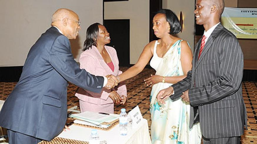Hon. Monique Nsanzabaganwa (2nd left) and Director General of Rwanda Cooperatives Agency Damien Mugabo congratulate new office bearers after the Election (Photo; J. Mbanda)